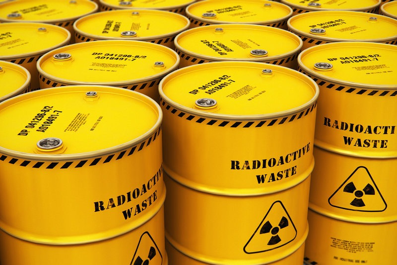 Group of stacked yellow drums with radioactive waste